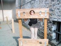 Sandra in the stocks at the museum