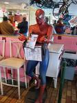Spiderman reads our book at Pollock Johnny\'s