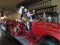 Sandra and Stan trying to be firemen at Firehouse Museum, Jacksonville